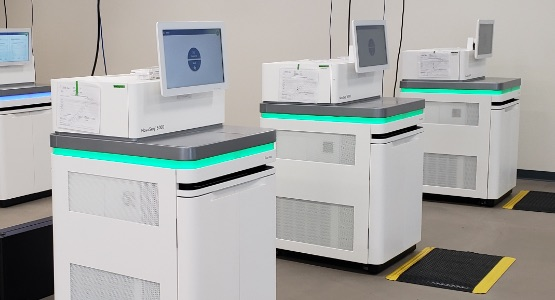 Photo of machines in the Genome Center lab
